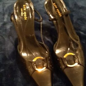 A pair of Kate Spade shoes